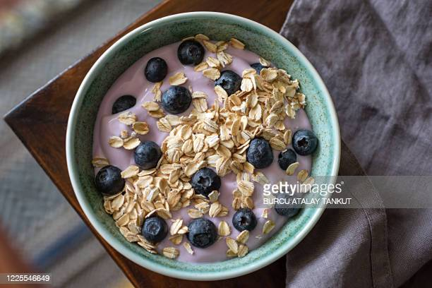 toasted oats and yogurt with blueberries - granola stock pictures, royalty-free photos & images