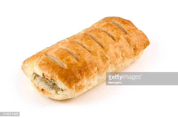 Toasted sausage roll on white background