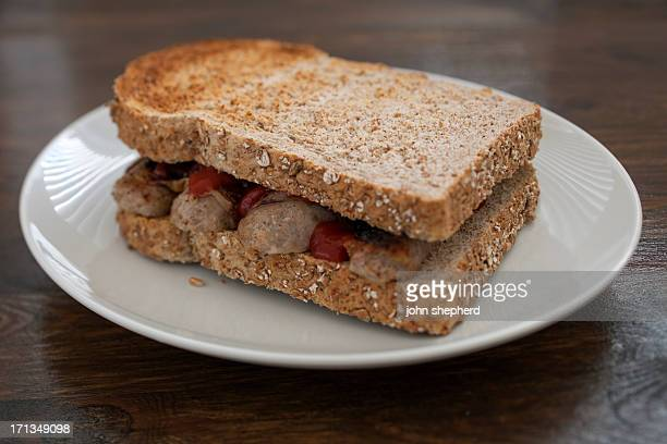 toasted sausage sandwich with tomato sauce - sausage sandwich stock pictures, royalty-free photos & images