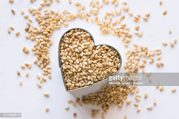 toasted sesame seeds in a heart shape - sesame stock pictures, royalty-free photos & images