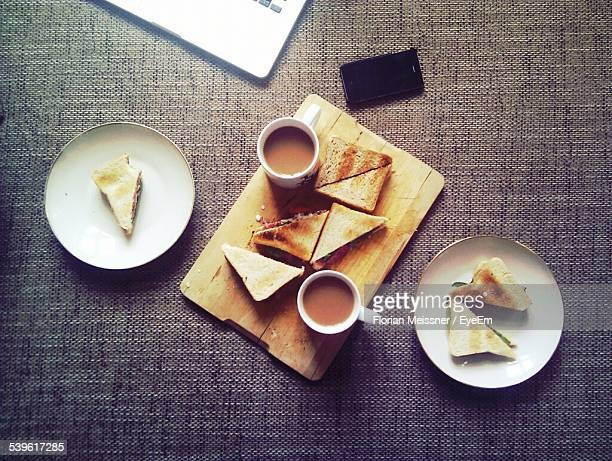 Toasted Snacks With Cheese And Coffee