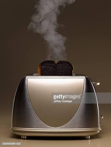 Toaster with smoking burned toast