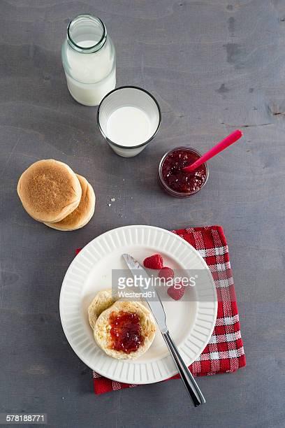 Toasties with strawberry raspberry jam and glass of milk