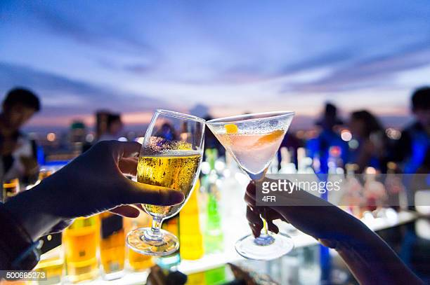 toasting, cheers! - cocktail stock pictures, royalty-free photos & images