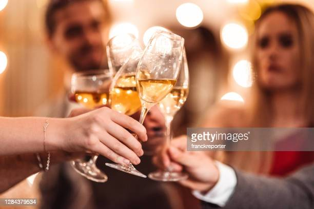 toasting for the arrive of the new year - political party stock pictures, royalty-free photos & images