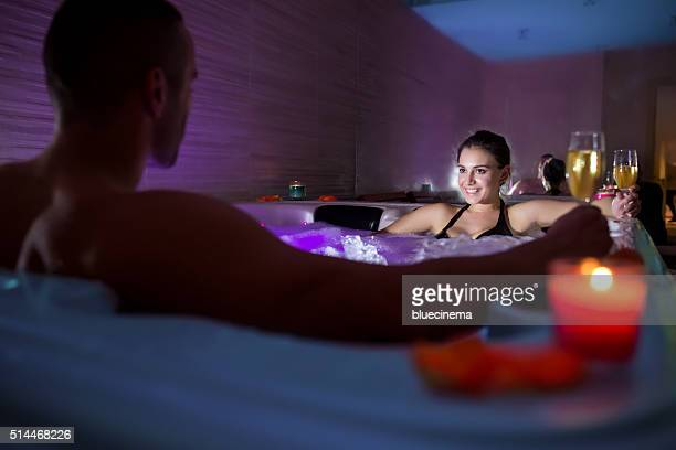 toasting in hot tub - couple bathtub stock pictures, royalty-free photos & images