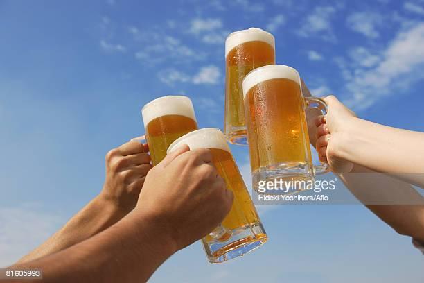 toasting of beer - human face foto e immagini stock