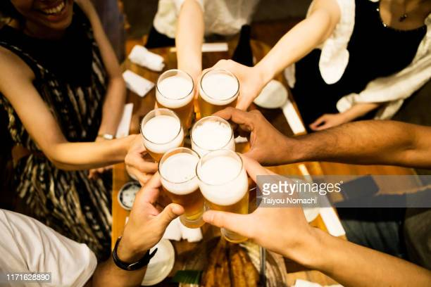 toasting people - pub stock pictures, royalty-free photos & images