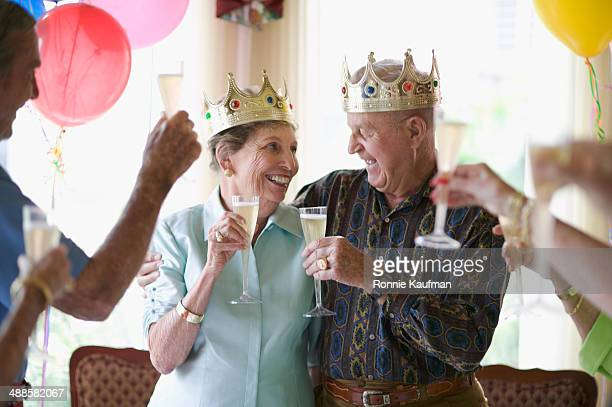 Toasting Senior Couple on Anniversary
