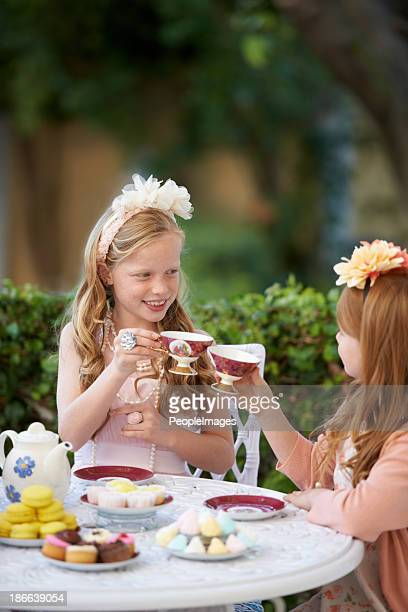 toasting to their imagination - tea party stock pictures, royalty-free photos & images