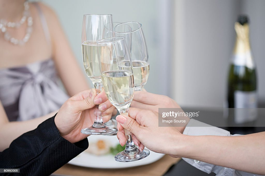 Toasting with champagne : Stock Photo