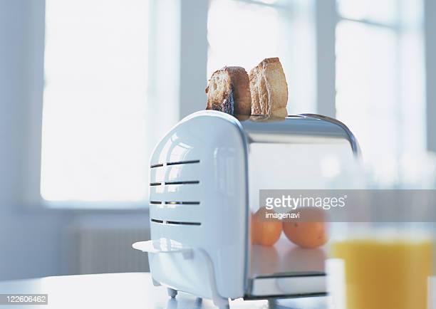 Toasts and toaster, orane juice