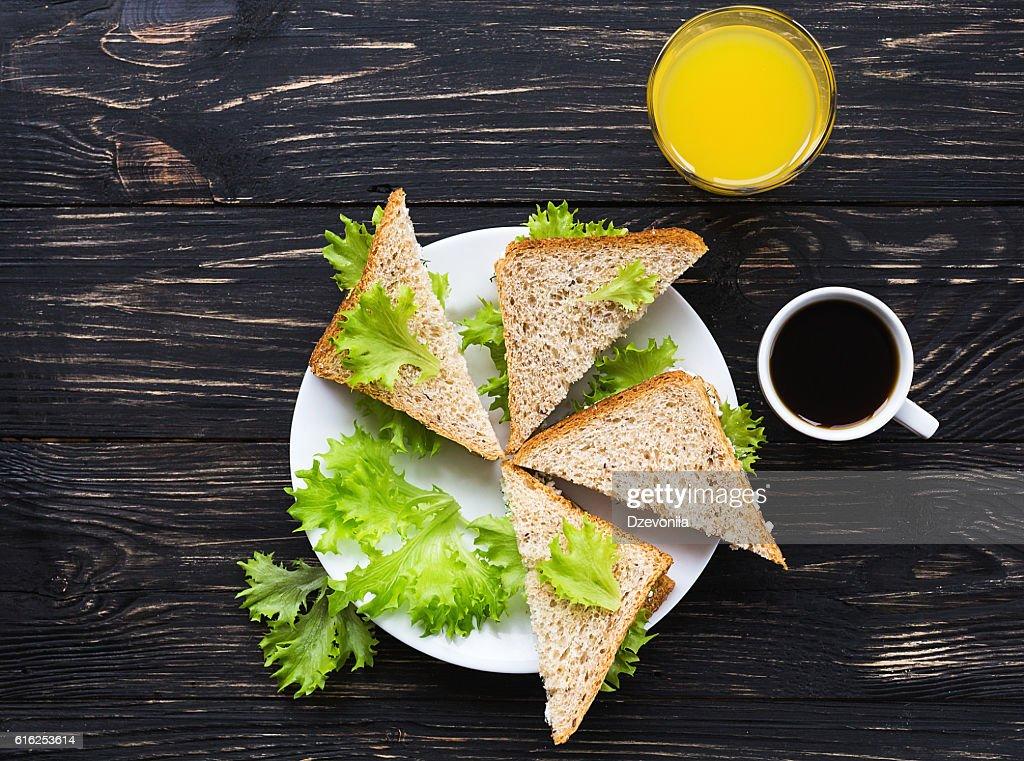 Toasts, cup of coffee and orange juice : Foto de stock