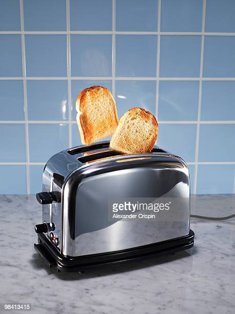 toasts in a toaster. - toasting stock pictures, royalty-free photos & images