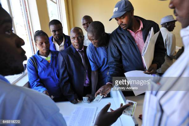 Tobacco growers collect their checks after selling their tobacco on the tobacco floor at the Boka Auction Floor Harare Zimbabwe April 17 2012 More...
