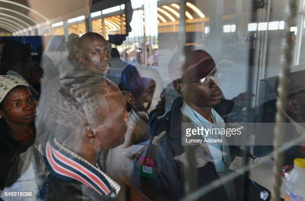 Tobacco growers wait in line to confirm their tobacco has been delivered to the auction house at the Boka Auction Floor Harare Zimbabwe April 16 2012...