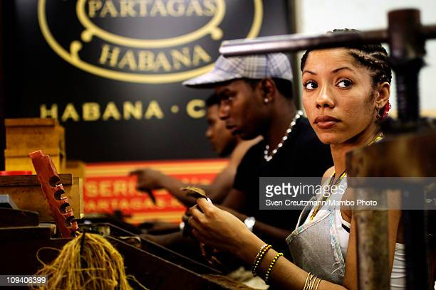 A tobacco worker rolls Cuban cigars in the Partagas cigar factory in Old Havana during the 13th Habanos Festival on February 24 2011 in Havana Cuba...