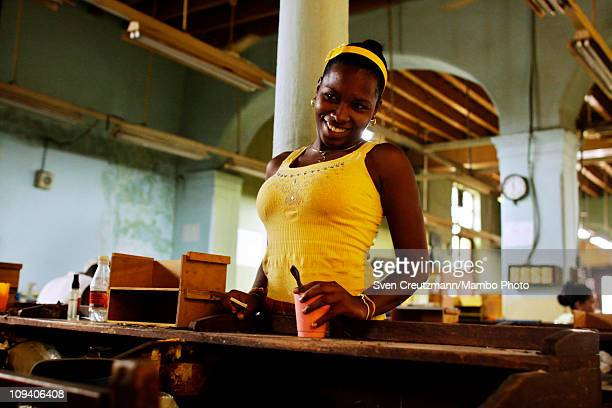 A tobacco worker shares a joke with a fellow worker in the Partagas cigar factory in Old Havana during the 13th Habanos Festival on February 24 2011...