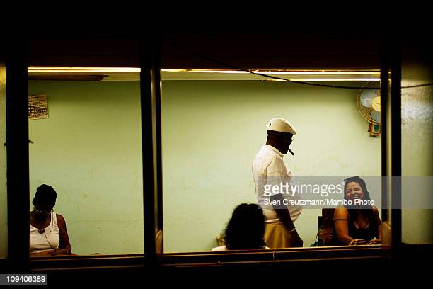Tobacco workers laugh in the Partagas cigar factory in Old Havana during the 13th Habanos Festival on February 24 2011 in Havana Cuba The Partagas...
