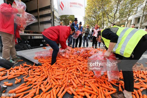 Tobacconists throw carrots on the street as they demonstrate against the increase to 10 euros of the price of a packet of cigarettes scheduled by the...