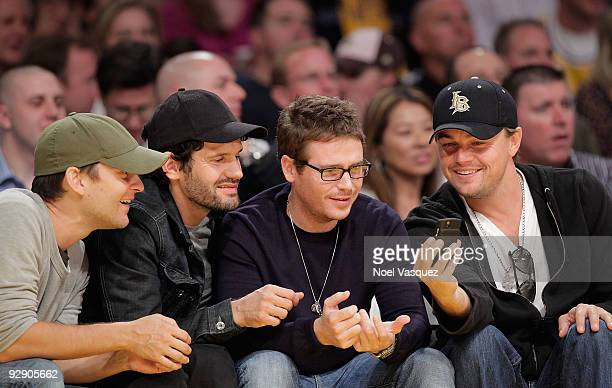 Tobey Maguire David Bortolucci Kevin Connolly and Leonardo DiCaprio attend a game between the New Orleans Hornets and the Los Angeles Lakers at...