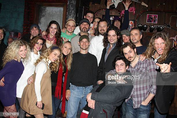 Tobey Maguire poses with the cast backstage at Rock of Ages off Broadway at New World Stages on January 5 2009 in New York City