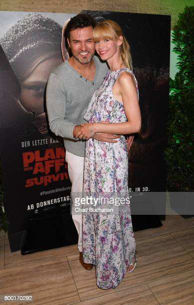 Tobey Wilson and Sabrina Gehrmann attend the 'Planet der Affen' Special Screening in Berlin at Astor Film Lounge on June 23 2017 in Berlin Germany