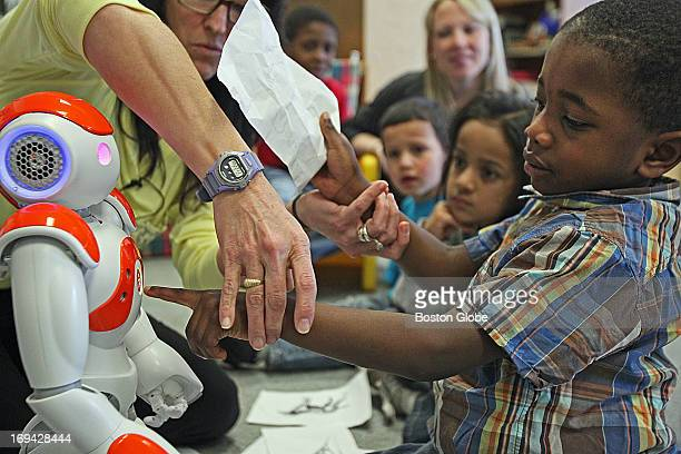Tobi Adebayo reaches out to the robot The Moody School in Haverhill is one of just three places in the world using the NAO robot to work with...