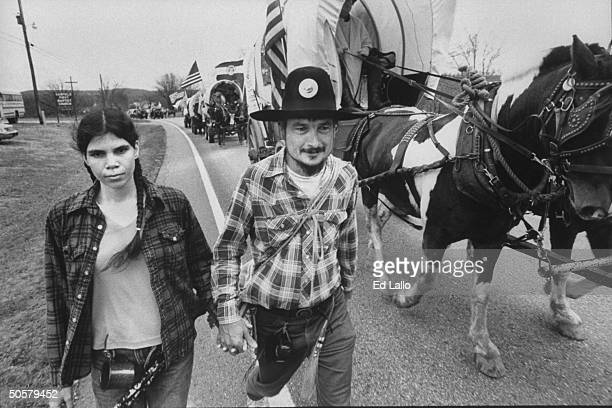 Tobi Larry Brown walking along Trail of Tears alongside horsedrawn covered wagons reenacting the 1000mile journey that the Cherokees traveled 150...