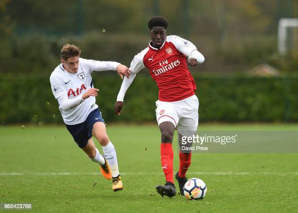 Tobi Olmole of Arsenal takes on Jack Roles of Tottenham during the match between Tottehma Hotspur and Arsenal on October 23 2017 in Enfield England