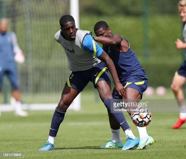 Tobi Omole and Serge Aurier of Tottenham Hotspur during the Tottenham Hotspur pre-season training session at Tottenham Hotspur Training Centre on...