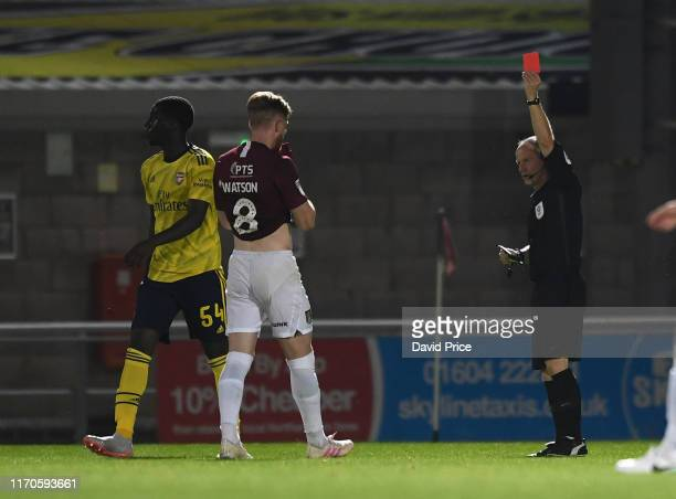 Tobi Omole of Arsenal is shown the red card during the Leasingcom match between Northampton Town and Arsenal U21 at PTS Academy Stadium on August 27...