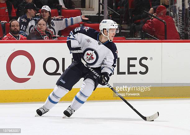 Tobian Enstrom of the Winnipeg Jets caries the puck during an NHL game against the Carolina Hurricanes on January 23 2012 at RBC Center in Raleigh...