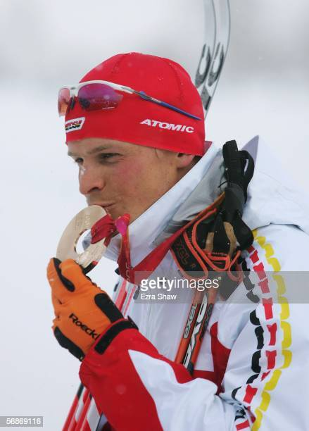 Tobias Angerer of Germany celebrates after winning the Bronze Medal in the Mens Cross Country Skiing 15km Interval Start Final on Day 7 of the 2006...