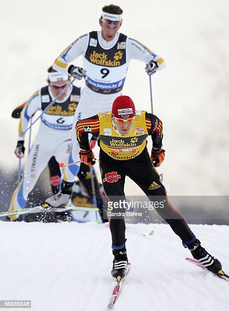 Tobias Angerer of Germany skates ahaed of Anders Soedergren and Mathias Fredriksson of Sweden during the men's 15 km pursuit of the Cross Country...