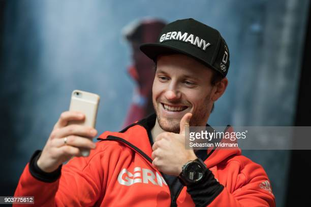 Tobias Arlt gives a thumbs up while taking a selfie during the 2018 PyeongChang Olympic Games German Team Kit Handover at Postpalast on January 11...