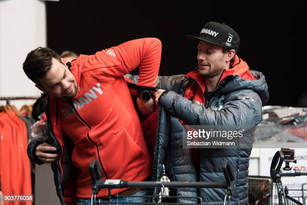 Tobias Arlt helps Tobias Wendl into a jacket during the 2018 PyeongChang Olympic Games German Team Kit Handover at Postpalast on January 11 2018 in...