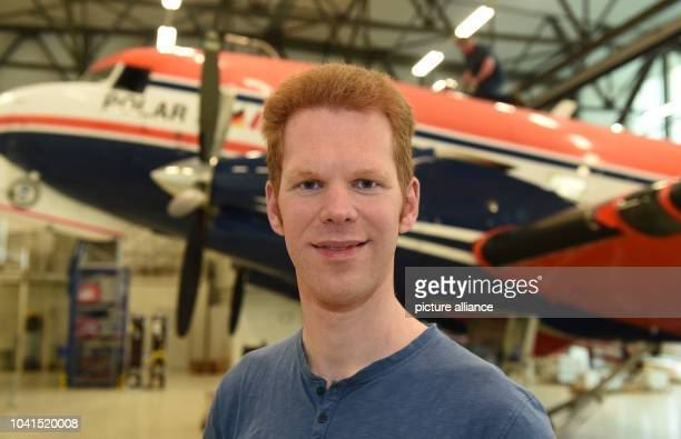 Tobias Binder from the Alfred Wegener Institute standing in front of the 'Polar 5' aircraft in the hanger at the airport in Bremen Germany 07 March...
