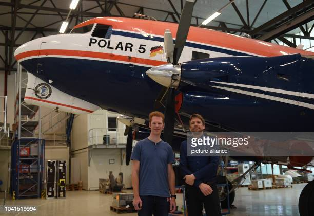 Tobias Binder und Olaf Eisen from the Alfred Wegener Institute standing in front of the 'Polar 5' aircraft in the hanger at the airport in Bremen...