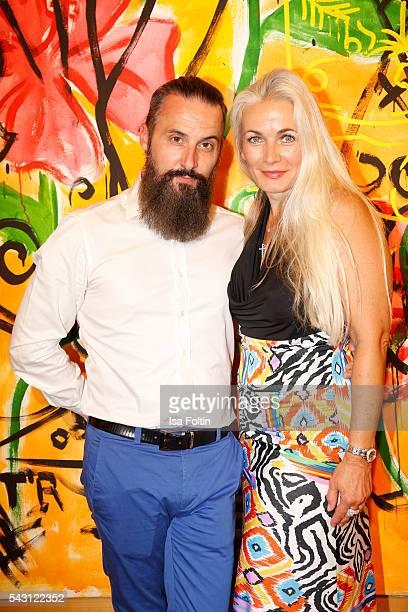 Tobias Bojko and former Bond girl Simone Bechtel attend the 'Glatzel Szczesny New York Saint Tropez meets Berlin' Exhibition Preview at Sankthorst...