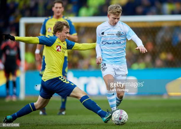 Tobias Christensen of FC Helsingor and Simon Tibbling of Brondby IF compete for the ball during the Danish Alka Superliga match between Brondby IF...