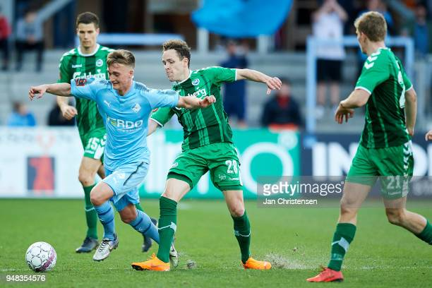 Tobias Damsgaard of Randers FC and Anders K Jacobsen of OB Odense compete for the ball during the Danish Alka Superliga match between Randers FC and...