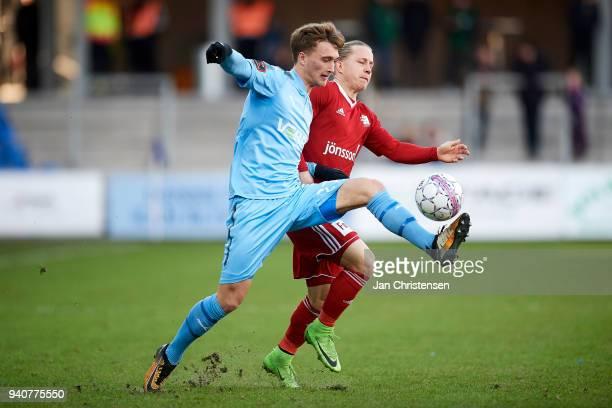 Tobias Damsgaard of Randers FC and Jesper Christjansen of Lyngby BK compete for the ball during the Danish Alka Superliga match between Randers FC...