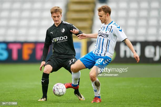 Tobias Damsgaard of Randers FC and Troels Klove of OB Odense compete for the ball during the Danish Alka Superliga match between OB Odense and...