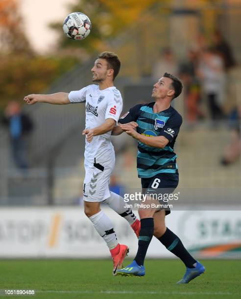 Tobias Dombrowa of SV Babelsberg 03 and Vladimir Darida of Hertha BSC during the friendly match between Hertha BSC and the SV Babelsberg 03 at the...
