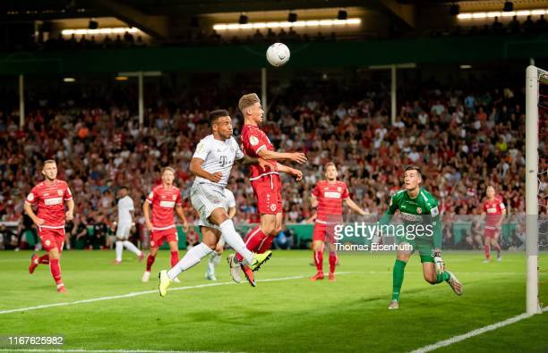 Tobias Eisenhuth of Cottbus is challenged by Corentin Tolisso of Muenchen during the DFB Cup first round match between Energie Cottbus and FC Bayern...