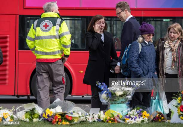 Tobias Ellwood looks at floral tributes in Parliament Square on the first anniversary of the Westminster Bridge terror attack on March 22 2018 in...