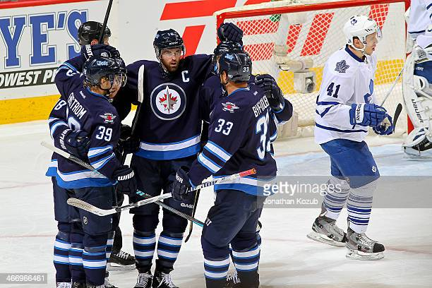 Tobias Enstrom Bryan Little Andrew Ladd Michael Frolik and Dustin Byfuglien of the Winnipeg Jets celebrate a second period goal against the Toronto...