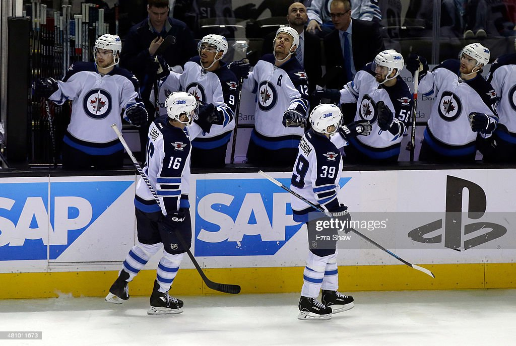 Tobias Enstrom #39 of the Winnipeg Jets is congratulated by teammates after he scored the game-winning goal against the San Jose Sharks at SAP Center on March 27, 2014 in San Jose, California.