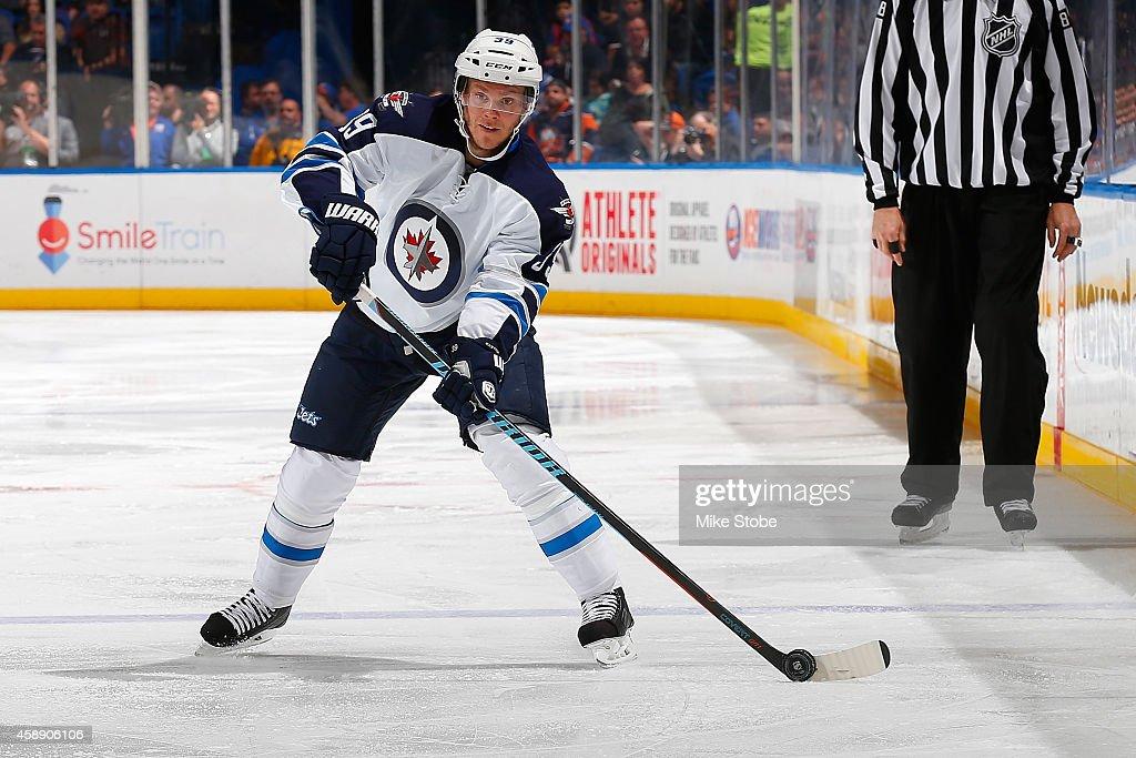 Tobias Enstrom #39 of the Winnipeg Jets skates against the New York Islanders at Nassau Veterans Memorial Coliseum on October 28, 2014 in Uniondale, New York. The Winnipeg Jets defeated the New York Islanders 4-3.